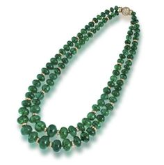 An emerald and diamond necklace, Bulgari  composed of 104 graduated emerald beads, measuring approximately 19.6-19.2 x 13.9mm. to 7.2-7.0 x 5.1mm., accentuated by round brilliant-cut diamond rondels, completed by a round brilliant-cut diamond boule clasp; signed Bulgari