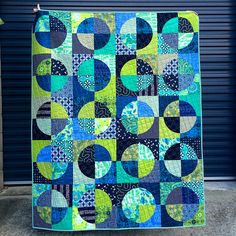 A few weeks ago I shared this blue and green drunkard's path quilt top. I think I got it basted pretty quickly after that but it has taken me a while to get it quilted.  For this quilt I used a kind