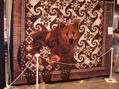 """Bear on the Trail"" and the quilt artist is Janet Fogg  -- Variation of Judy Martin pattern ""Shakespeare in the Park"" (no bear in that one!)"
