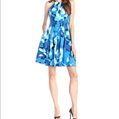 Calvin Klein Dress This fit and flare dress has scatters of white and dark blue. Calvin Klein Dresses Midi