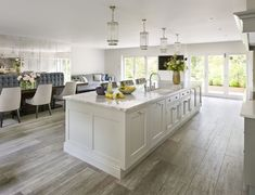 The owners of this North London house love nothing more than entertaining, and so built a kitchen extension in order to give them the space they needed. The clients had spent a lot of time researching kitchens and had already chosen cabinetry in Martin Moore's New Classic design. This contemporary classic look has been beautifully showcased by a palate of cool greys.