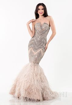 exquisite   strapless evening gown with modifed sweetheart neckline and art deco inspired   rhinestone embellishment covering the body and leading into a feather adorned   mermaid hem