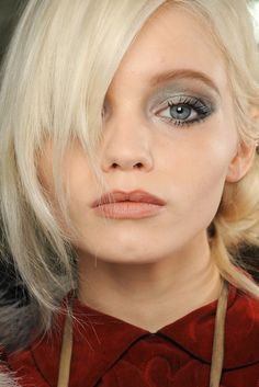 Abbey Lee Kershaw with gorgeous silvery gray eyeshadow and her palest blonde locks backstage beauty at Chanel Fall rtw 2011