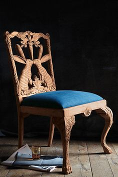 I need this chair <3 Handcarved Menagerie Dining Chair - anthropologie.com