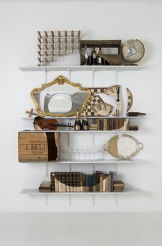 Artist James Hopkins created skulls out of different household items he arranged on several bookshelves.