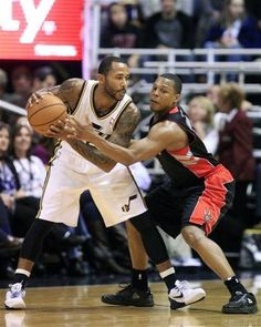 Toronto Raptors guard Kyle Lowry defends against Utah Jazz guard Mo Williams, left, during the first quarter during an NBA basketball game, Friday, Dec. 7, 2012, in Salt Lake City. (AP Photo/Rick Bowmer)