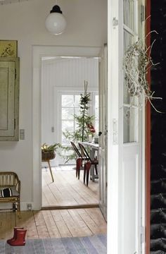 Scandinavian-love the wood floors, the white paint, the windows, everything.