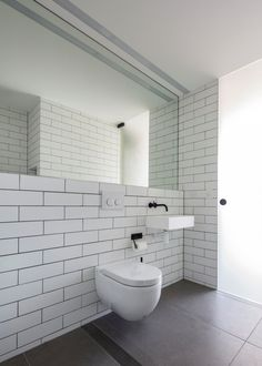 toilet by Nobbs Radford Architects. Contemporary redesign of a cottage in Birchgrove, a suburb of Sydney, Australia.