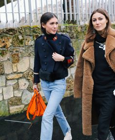 Diletta Bonaiuti in a Gucci jacket and Loewe bag and Giorgia Tordini in a Loewe top and Joseph coat