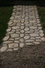 How to build a faux stone walkway for around $40 http://www.budget101.com/gardening-landscaping/how-build-faux-stone-walkway-502.html