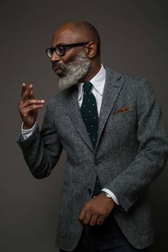 Smart outfit with a grey herringbone Harris Tweed blazer and a white shirt.