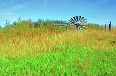 """""""Lying Down on the Job"""" by Nikolyn McDonald Photography adds a painted look to a photo of an old, abandoned windmill in a field.  Brightly colored layers of grass and sky give the picture a festive look. hill,country,rural,wind,kansas,farm,energy,vintage,american,usa,summer,agriculture,water,blades,horizontal,mechanical,machine,power,prairie,farming,traditional,mill,wind-pump,rotational,vanes,sails,midwest,midwestern,rooks,graham,county,nikki"""