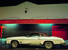 The cover for Langdon Clay's <em> Cars - New York City, 1974-1976</em>, showing the <em>Marlin Room Car, Cutlass Supreme in front of the Marlin Room and Lounge connected to Clam Broth House, Hoboken, NJ, 1975.</em>