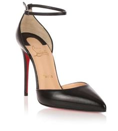Black shiny nappa leather d'Orsay pump from Christian Louboutin. The Uptown pump has a 100mm seamless stiletto heel, a narrow adjustable ankle strap, and a pointed toeTrue to sizeRed leather soleMade in ItalyCLICK for Louboutin red soles care advice!