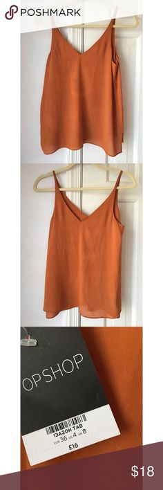 Orange Topshop Tank NWT Burnt orange color, flowy lightweight material. New with tags, in perfect condition. Size 4. Purchased abroad. Topshop Tops