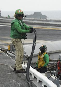 GULF OF OMAN (June 13, 2013) – Chief Aviation Boatswain's Mate (Equipment) Braulio Galvan moves a rubber gasket from a catapult off the flight deck of the aircraft carrier USS Nimitz (CVN 68) for flight operations. Nimitz Strike Group is deployed to the U.S. 5th Fleet area of responsibility conducting maritime security operations and theater security cooperation efforts. (U.S. Navy photo by Mass Communication Specialist 2nd Class Devin Wray/Released)