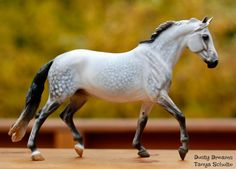 This breathtaking paint job was performed on the Breyer Giselle mold by Artist Tom Bainbridge. His dapple gray horses are spectacular and so exquisitely detailed!