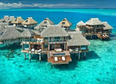 The Hilton, Bora Bora.. Honeymoon heaven! Want to go here voodoo bad.