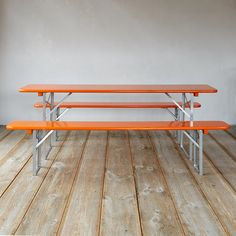 """Made in Germany for use at festivals throughout the country, these time-tested table and bench sets offer functional seating for gatherings throughout the seasons. A pine top pairs with sturdy, steel legs that fold flat for convenient storage and transport from garden party to pumpkin patch.- Set includes table and two benches- Pine wood, iron- Indoor or outdoor use- GermanyTable: 30.5""""H, 20""""W, 86""""LBench: 19""""H, 10""""W, 86.5""""L"""