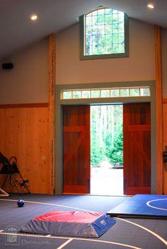 Barn door hardware for garage workout room