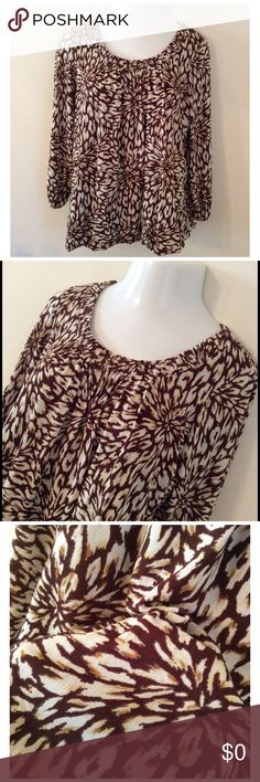 Cream and Brown Top .3/4 Sleeve, Top is 100% Nylon, lining 100% Polyester.  Hem and Sleeve have a puckered effect.  Very cute top. Kasper Tops Tunics