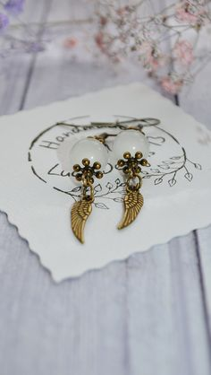 Excited to share the latest addition to my #etsy shop: BoHo Earrings Dangle - Angel Wing Earrings Handmade - Antique Brass Earrings - Bohemian Jewelry For Her - Cat Eye Beads Earrings For Women https://etsy.me/2qpEGbf #jewelry #earrings #white #boho #earwire #girls #br