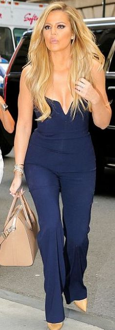 Khloe Kardashian: Purse – Givenchy  Shoes – Christian Louboutin  Jumpsuit – Galvan
