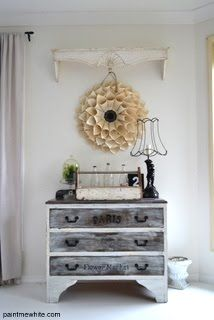 Shades of white and gray. Lovely shelf above the art on the wall. Crate front dresser.