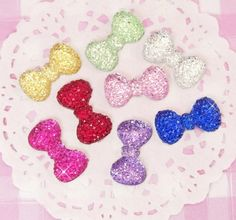 Cute and colourful sparkling bows in an array of colours! These flat back #cabochons are made from clear resin with gorgeous pearlised star sequins in the middle. #Kawaii