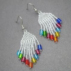 Beautiful rainbow goodness! Just looking at these unique earrings makes me smile from ear to ear! Crystal white seed beads with a colorful glass bead at each bottom. Nickel free plating, hypo-allergen