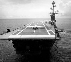 Navy F3D Aircraft shown on deck of USS Antietam (CVS-36) immediately following landing in which the pilot did not touch the controls. The landing was accomplished by the use of the Bell Automatic Carrier Landing System housed in the control and guidance units seen in the foreground, August 1957.