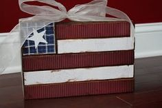 American flag made from scrap wood and paper.