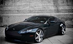Aston Martin - Founded: Founder: Lionel Martin, Robert Bamford. The current version of the Aston Martin logo contains a green rectangle on top of the white wings, sporting the company's name in uppercase. Aston Martin Lagonda, Aston Martin Cars, Aston Martin Vantage, My Dream Car, Dream Cars, Bugatti, Fuel Efficient Cars, Automobile, Cars And Coffee