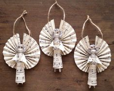 Clothespin Angels - Handmade Ornaments made with Vintage Sheet Music - Set of 3. 27.50, via Etsy.