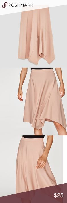 Zara Cape-Like Asymmetrical Skirt Pretty in Pink. This Flirty Zara Skirt is so cute and fits very nicely. Asymmetric Cut in the Front. Back Zipper. Size S, M, L. New w/Tags.  ❤️ I have over 90 Zara, New W/Tag items For Sale! I Love to Give Bundle Deals! Zara Skirts Asymmetrical
