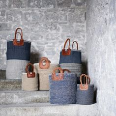 BOLIA BASKET These beautiful Bolia baskets are handmade by a collective of rural craftswomen in southern India. The bags are naturally dyed, hand spun and woven using natural fibres including jute, cotton and leather. They are ideal for storing bathroom bits, toys, kindling and logs. The baskets are rigid and free-standing.