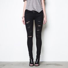 Ripped Mid Rise Skinny Jeans Powerstretch best selling Black Powerstretch fabrication gets any edgy update with heavy destruction from thigh to knee. The strategically placed rips are designed to enhance with wear and evolve into a bespoke style all your own. This material has undeniable impact and confidence-boosting ability: it shapes curves, hugs the waist, and lifts your backside. Used once! But like new! SOLD OUT ON THE SITE Dstld Jeans Skinny
