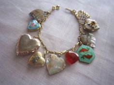 A vintage heart charm bracelet. Love this!