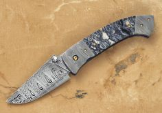 Tactical Customs | Custom Knives & Products