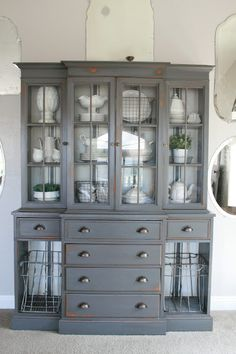 A dark grey (gray tabby) painted hutch with white ironstone, wire baskets and grain sack stripe painted interior. Furniture Projects, Furniture Makeover, Home Projects, Diy Furniture, Amish Furniture, Painted China Cabinets, Painted Hutch, Refinished China Cabinet, Farmhouse China Cabinet