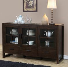 Organize and store your china and table linens in this beautiful dining room buffet with removable glass panels. The rich brown cabinet, constructed out of strong rubberwood, features three drawers and two large interior compartments of various sizes.