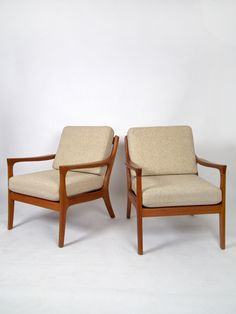 take a seat - or two - or three (not in this picture). Beautiful warm teak wooden Scandinavian design chairs