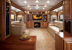 2 story luxury RV interior ideas ~ couches facing each other & fireplace RV living room. Rv Interior, Interior Design, Interior Ideas, Motorhome Interior, Trailer Interior, Luxury Rv Living, Rv Homes, Motor Homes, Tiny Homes
