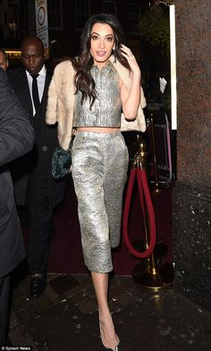 Hollywood beauty: The raven-haired brunette seemed to be enjoying her night out on the tow...