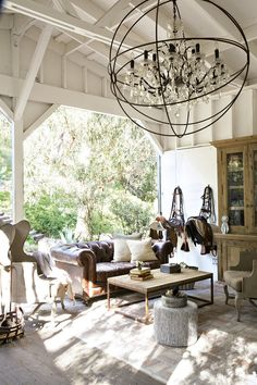 Wow!  Love this orb chandelier as the focal point for a french country bohemian outdoor living space.  Rather than the typical orb, this one features a crystal chandelier in the center to dress up the space.  And you'll be surprised how affordable it is!  - Northwest Lighting and Accents