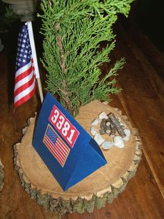 Boy Scouts centerpiece idea. Blue and Gold or District Dinner--instead of the other decor, put the cupcakes on the tree slice for those sitting at the table