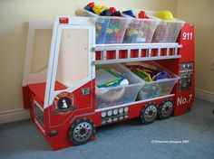 Fire Truck Toy Box at www.toyboxplan.com This site gives you the plans to build different toy storage organizers yourself! Decals sold separately if desired.