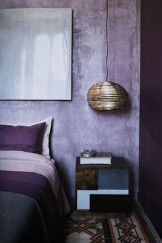 Aged purple wall in bedroom, via Dos Family.