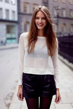 i love the look of a black bandeau top through a sheer white long sleeved shirt.