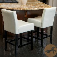 These barstools for the kitchen would be pretty easy to keep clean and would be a nice pop of white.